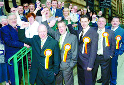 WINNERS: For Darwen candidates, from the left, Philip Jones, Tony Melia, Andrew Graham, Anthony Meleady and Trevor Maxwell celebrate after the election count
