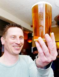 MINE'S A PINT: Andy Harding is having a special beer brewed for the centenary of Darwen Library