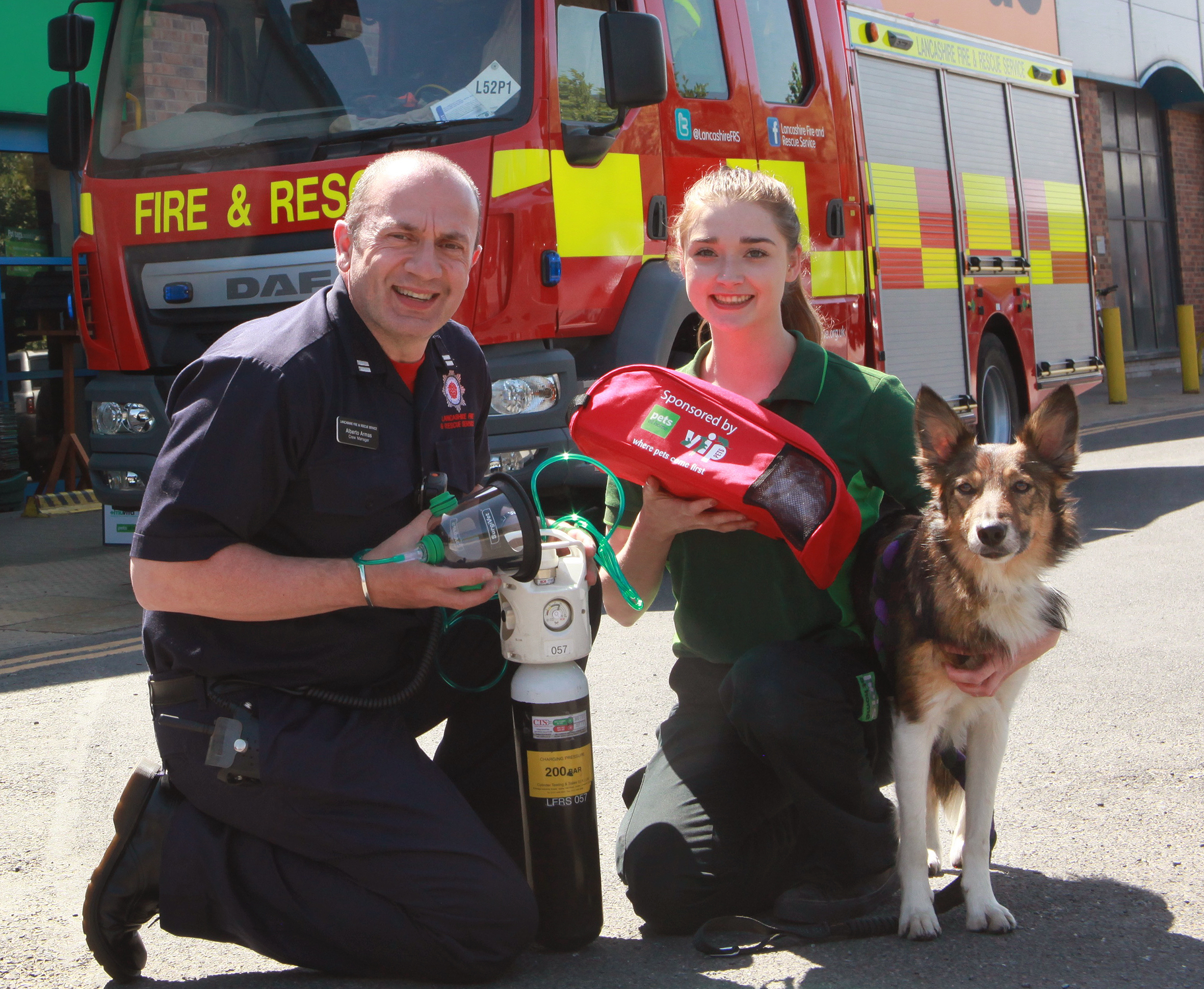 LIFESAVER: Firefighter Alberto Armas demonstrating the new pet equipment with representatives from Pets at Home, who helped Smokey Paws charity secure the cash