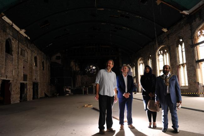 POTENTIAL: From left: Alastair Murdoch, chair of trustees, Resource Blackburn, James Sanderson, Purcell Architects with Shaheen Hussain and councillor Hussain Akhtar in the main hall on the first floor of the former Apollo cinema