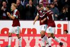 JOY: Burnley's Scott Arfield and Michael Kightly celebrate Sam Vokes' opening goal in the win over Everton