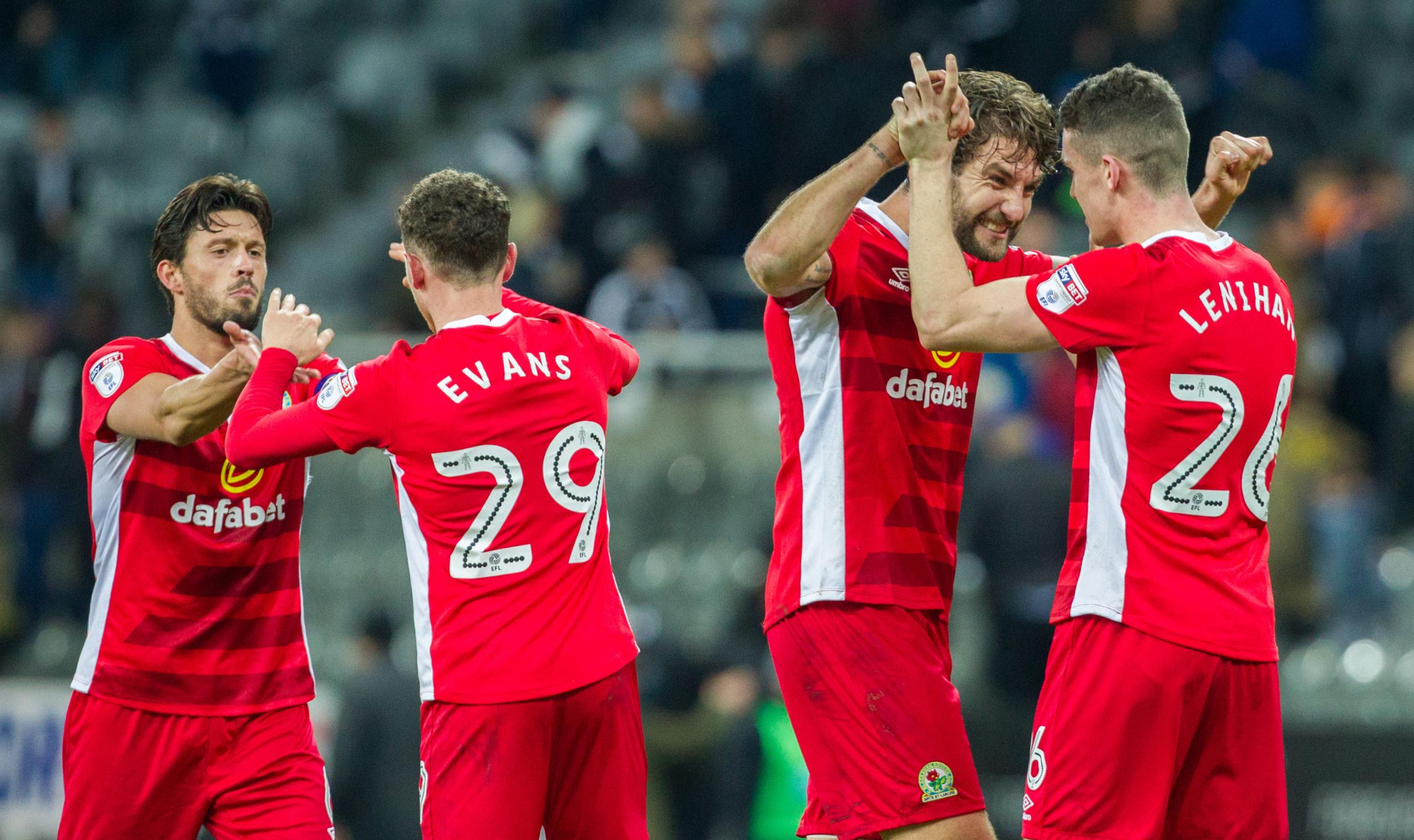 Blackburn Rovers' players, from left to right, Jason Lowe, Corry Evans, Charlie Mulgrew and Darragh Lenihan, celebrate after the final whistle