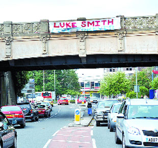 TRIBUTE: A banner hung from a bridge after the funeral of ex-BNP councillor Luke Smith