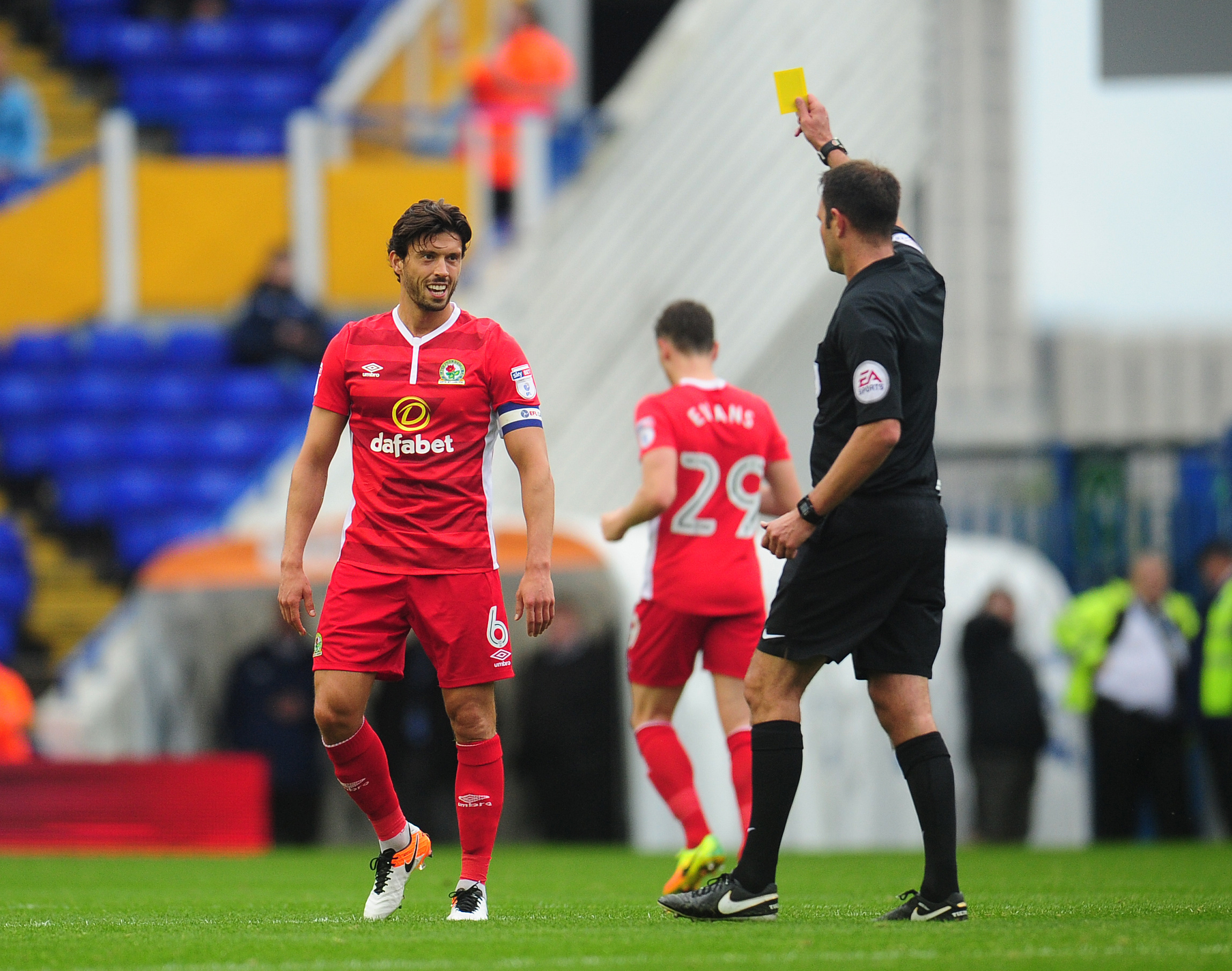 Blackburn Rovers' Jason Lowe is shown a yellow card by referee James Linington