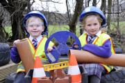 FUN: Reception class children Charlie Fowler-Turner and Helena Rishworth play in the school's construction area