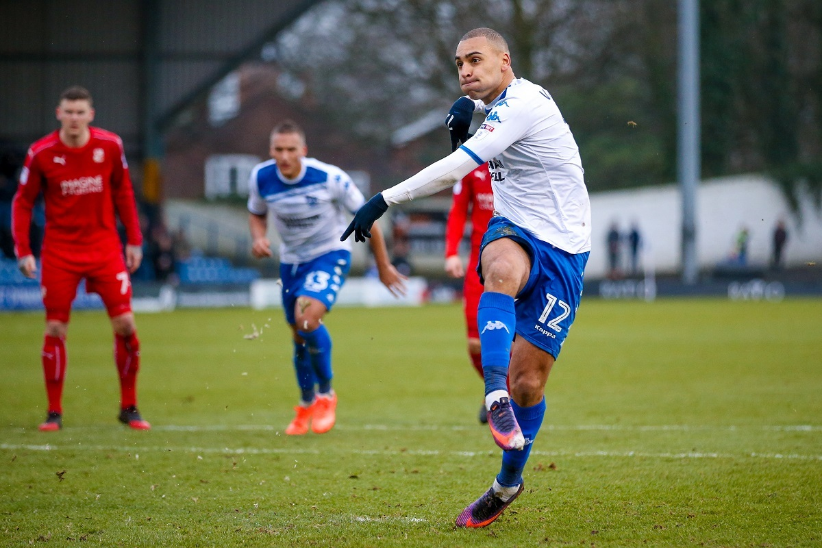 Bury forward James Vaughan strikes his match-winning penalty straight down the middle