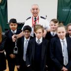 Lancashire Telegraph: Retired prison officer Derek Williams pictured with students Abbie Ward, Sufyaan Ali, Faizaan Hussain, Layton Ashcroft, Morgan Grimshaw, Ellie Thorpe and Poppy Berry from Rhyddings Business and Enterprise School