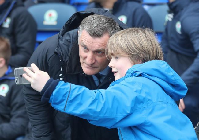 Blackburn Rovers boss Tony Mowbray with a young fan