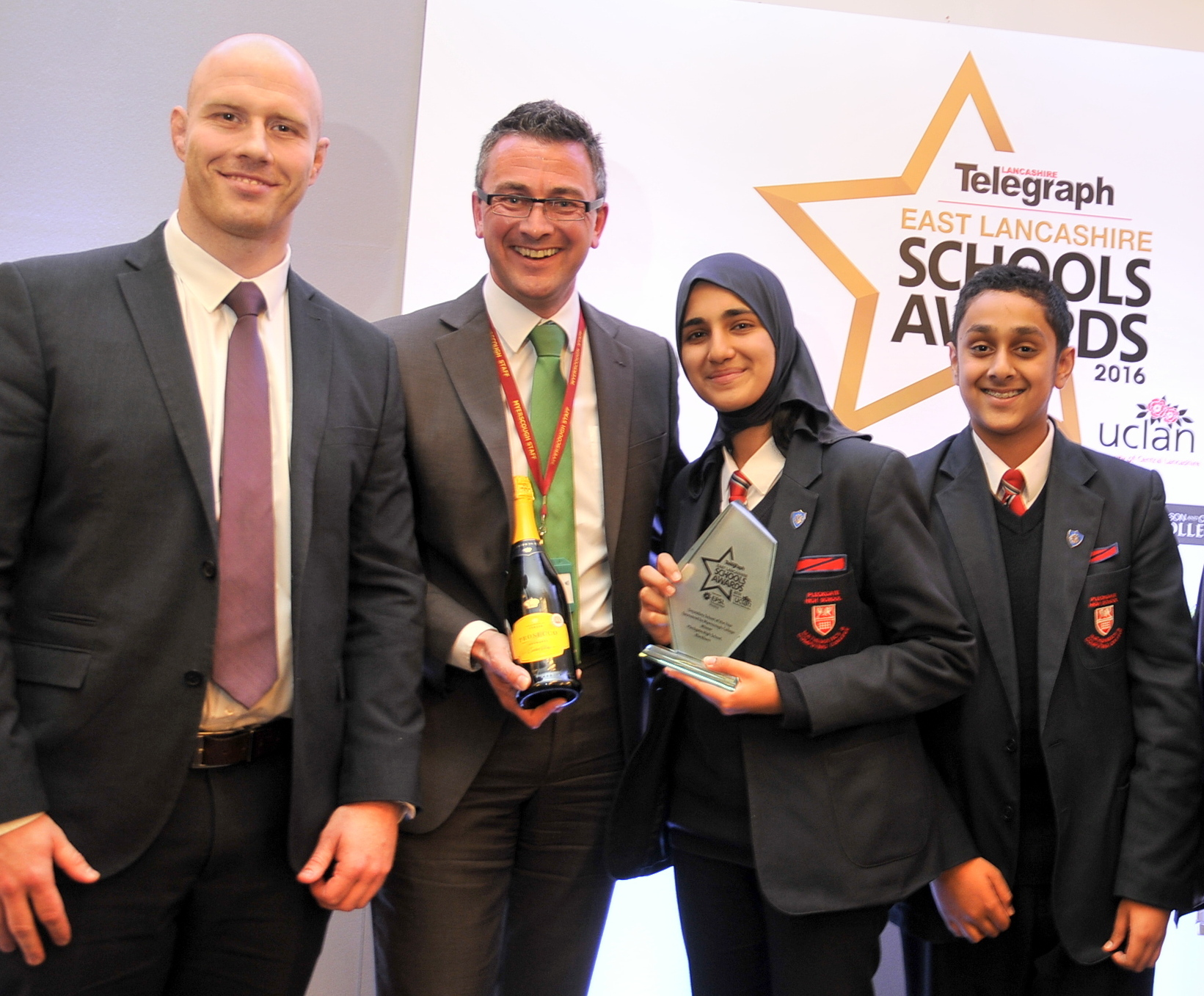 From left, Mark Cooper, Stuart Davidson (Myerscough College), Aysha Dagra and Abbaas Shakil and the Secondary School of the Year Award for Pleckgate High School.