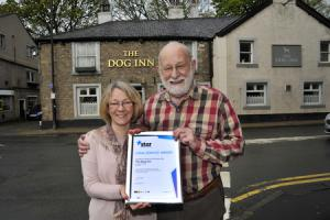 Toast: Norman Atty and wife Christine are celebrating 25 years behind the bar at The Dog Inn, Whalley
