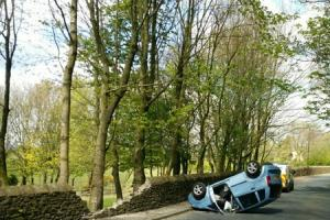 Man arrested after crashing into stone wall
