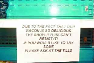 EMPTY DISPLAY: A notice explains why bacon has been moved