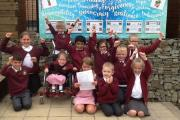Children at Barnoldswick CE Primary School celebrate their outstanding grade