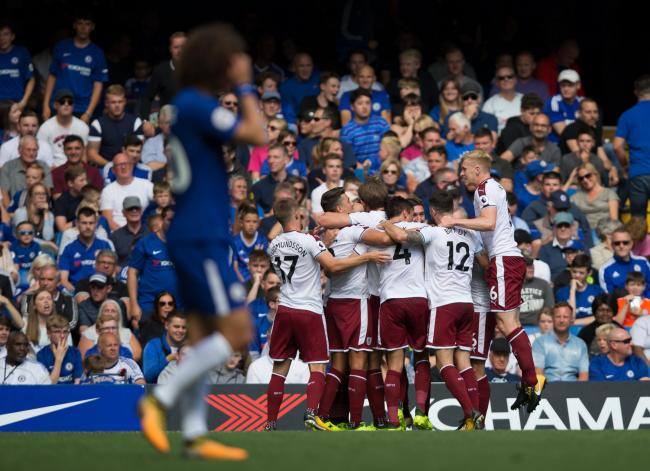 DESPAIR AND DELIGHT: Burnley celebrate a famous win at Stamford Bridge