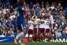 DELIGHT: Burnley players celebrate Sam Vokes' second goal in the 3-2 win at Chelsea