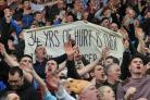 DERBY DAY DELIGHT: Burnley fans celebrate victory over Rovers at Ewood in March 2014
