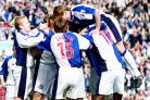 Blackburn Rovers players celebrate Craig Short celebrates his goal in the 5-0 win over Burnley