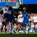 Lancashire Telegraph: DREAM START: Ben Mee gets up to head at goal during Burnley's 3-2 win at Chelsea last weekend