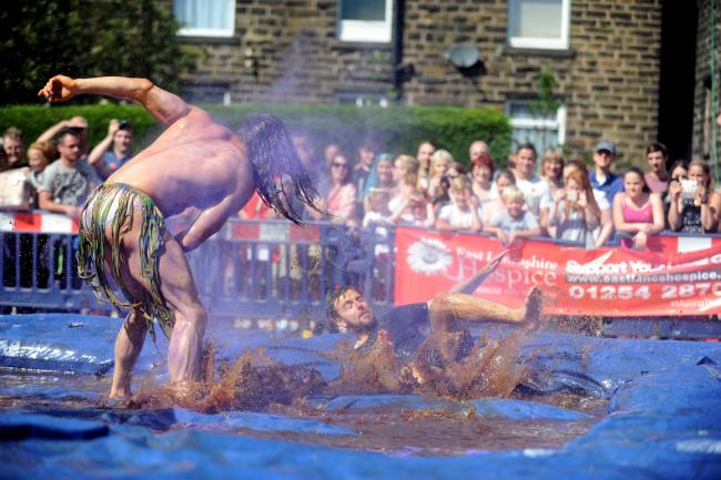 "Annual gravy wrestling championship at the Rose and Bowl pub, Stacksteads, Lancashire Telegraph reporter Neil Athey takes on Joel Hicks, ""The Wild Thing""."