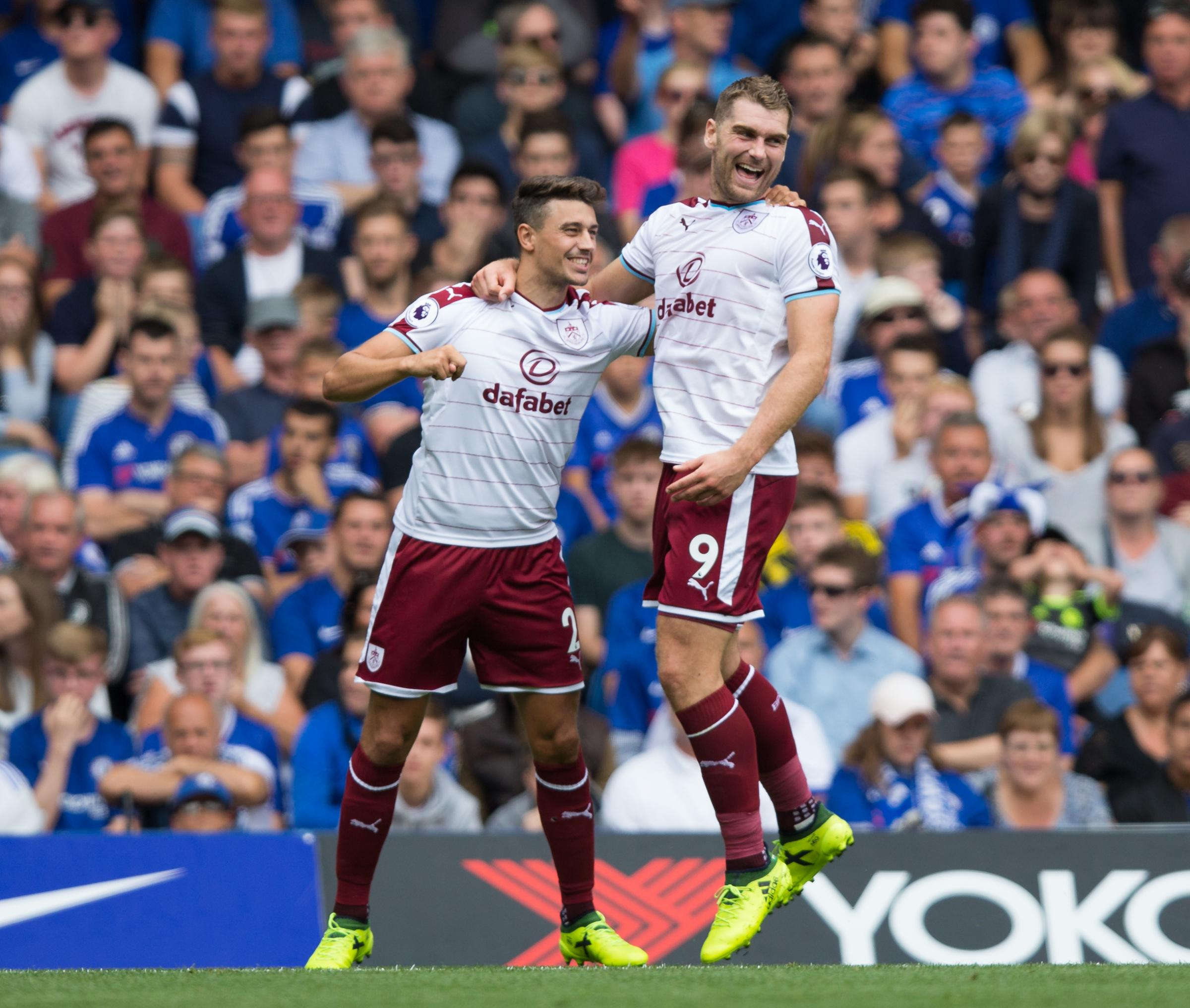 MAIN MAN: Sam Vokes, celebrating a goal at Chelsea last week with Matt Lowton, has improved his game after initiating a chat with boss Sean Dyche