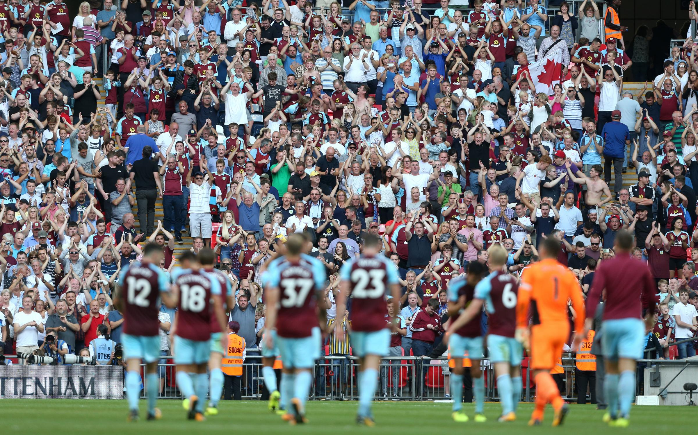 The Burnley fans applaud their players at the end of the game