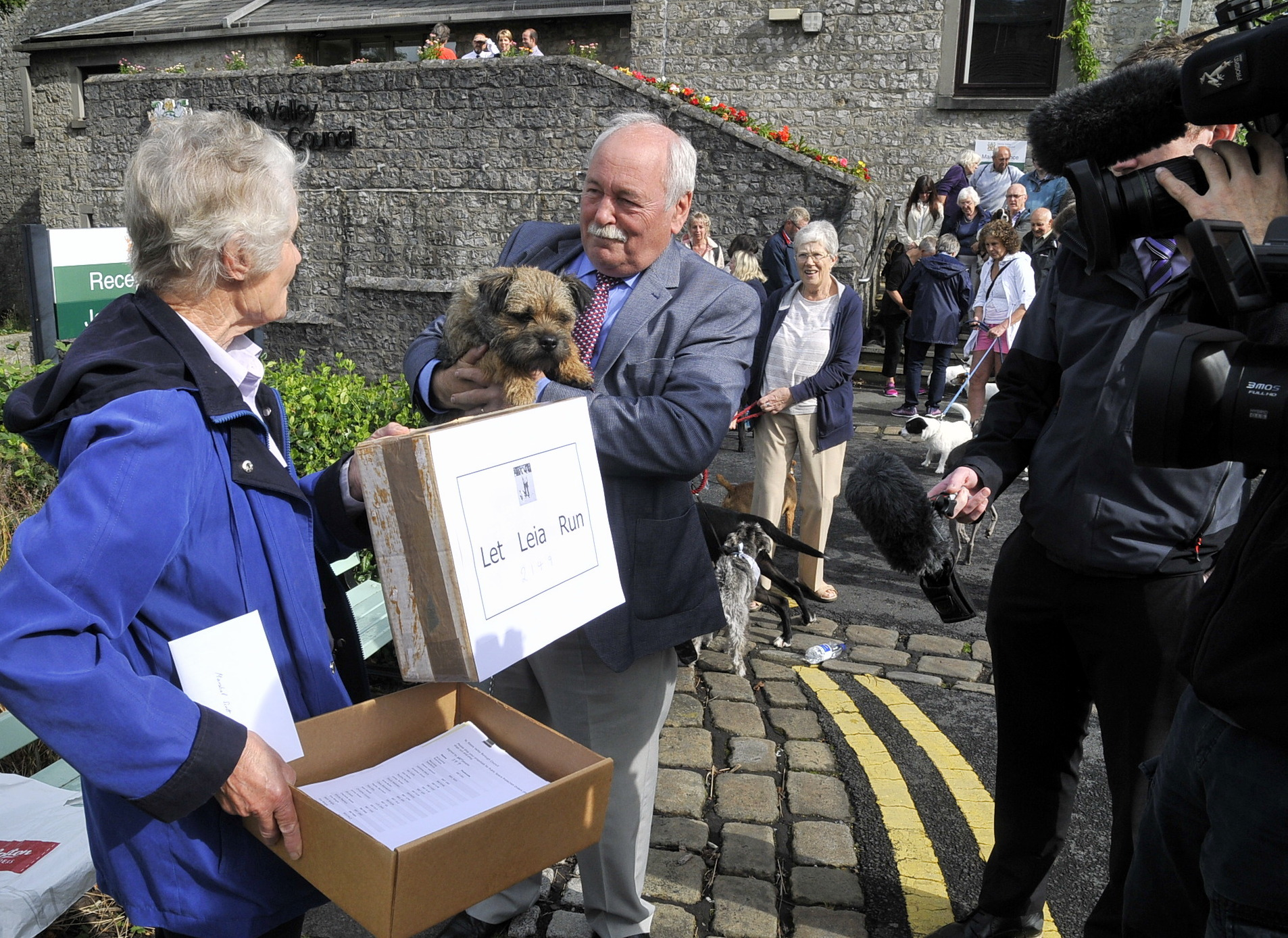 Penny Pitty handing over the petition to Cllr Ken Hind the leader of Ribble Valley Borough Council and his dog 'Jasper' in August