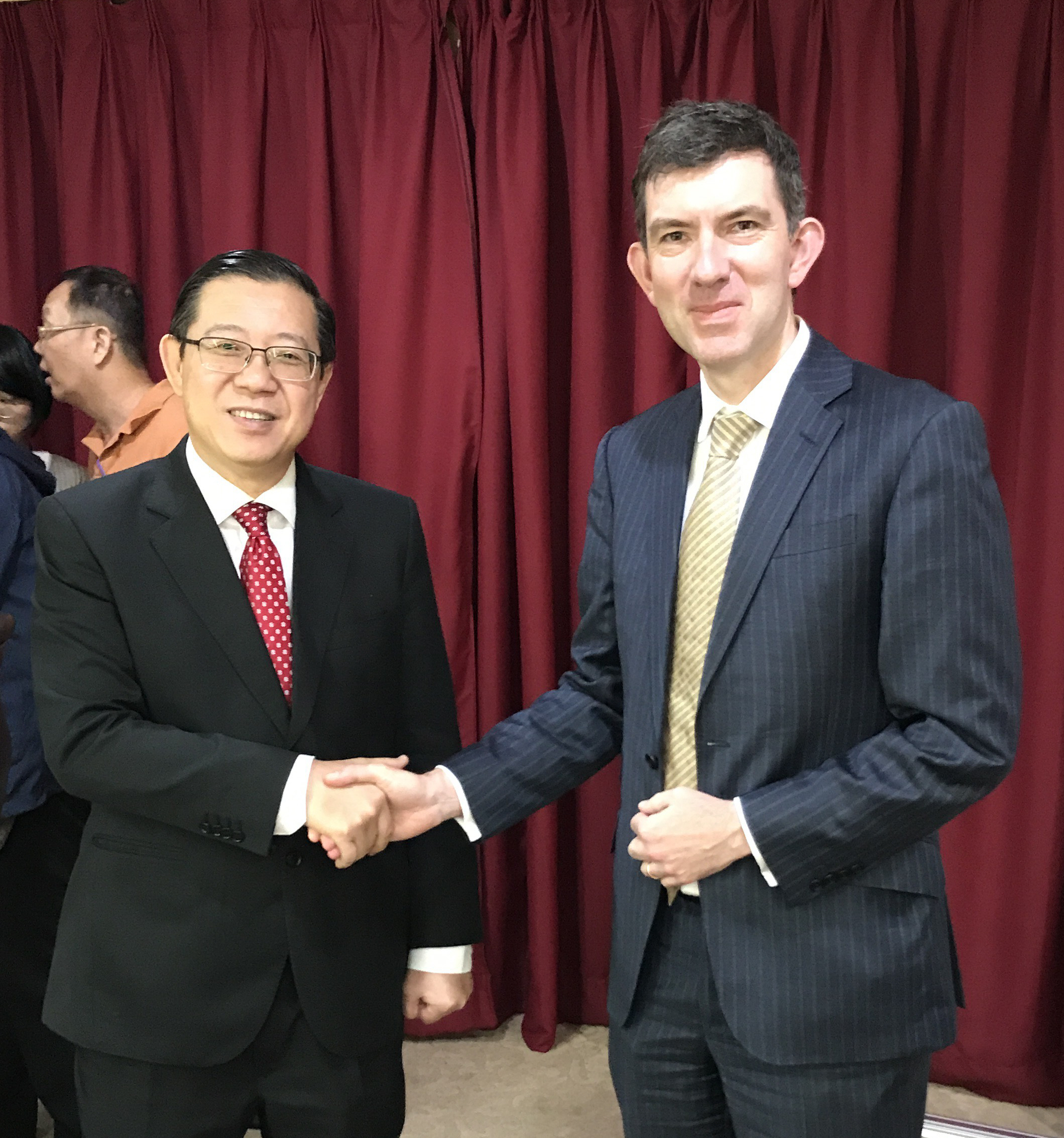 Headteacher John Browne with the chief minister of Penang Lim Guan Eng