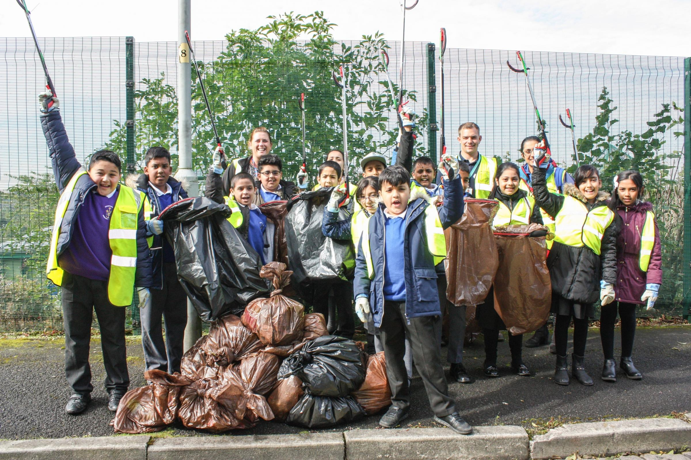 Youngsters from Stoneyholme Community Primary School after picking up more than 30 bags of rubbish
