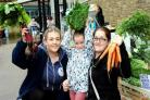 Sophie Marshall of Woods Fruit and Veg stall, Macy-Leigh Brown, five, and Lauren Brown from Darwen at a previous Darwen Food Festival