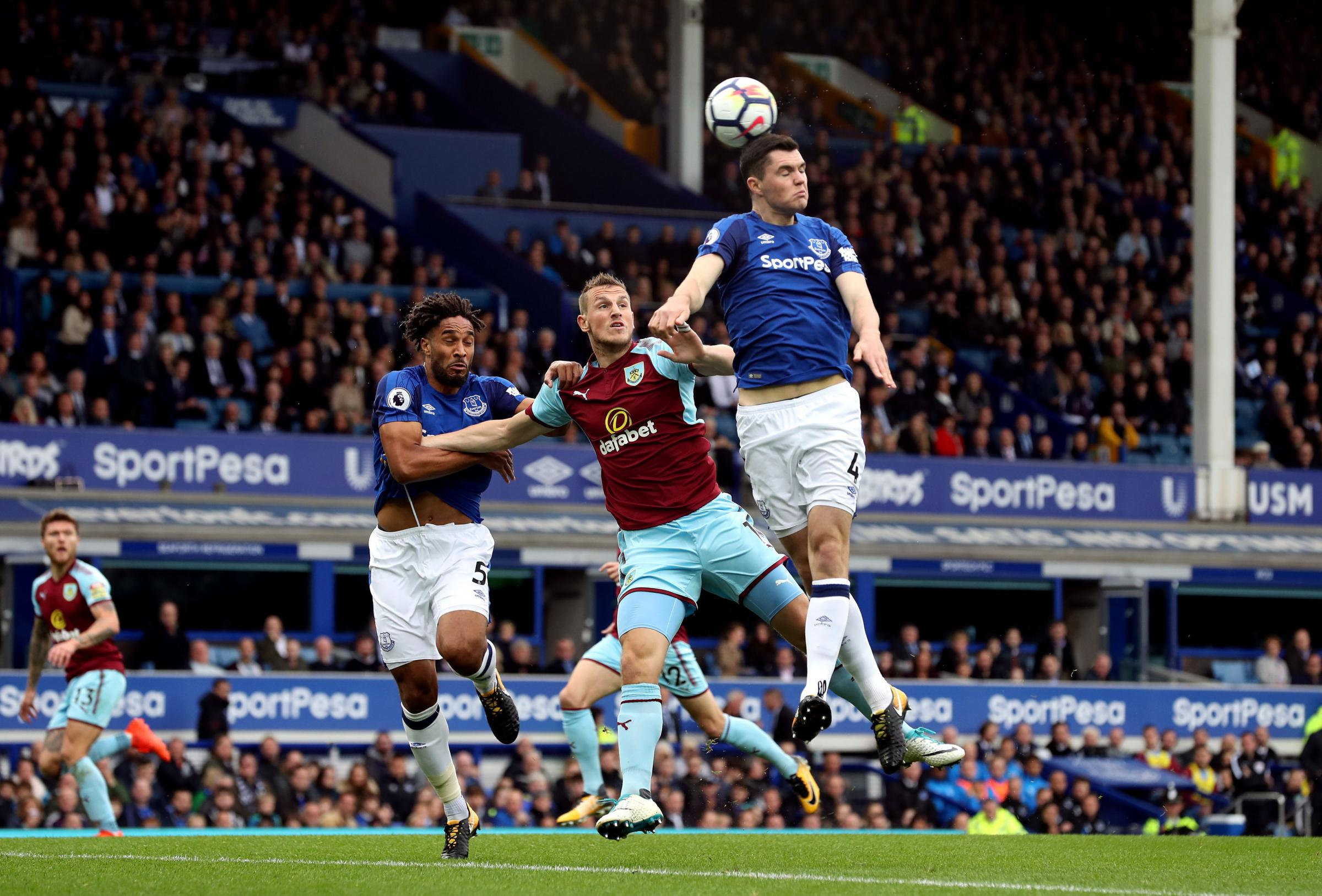 Michael Keane gets his head to the ball under pressure from Chris Wood during Burnley's win at Everton
