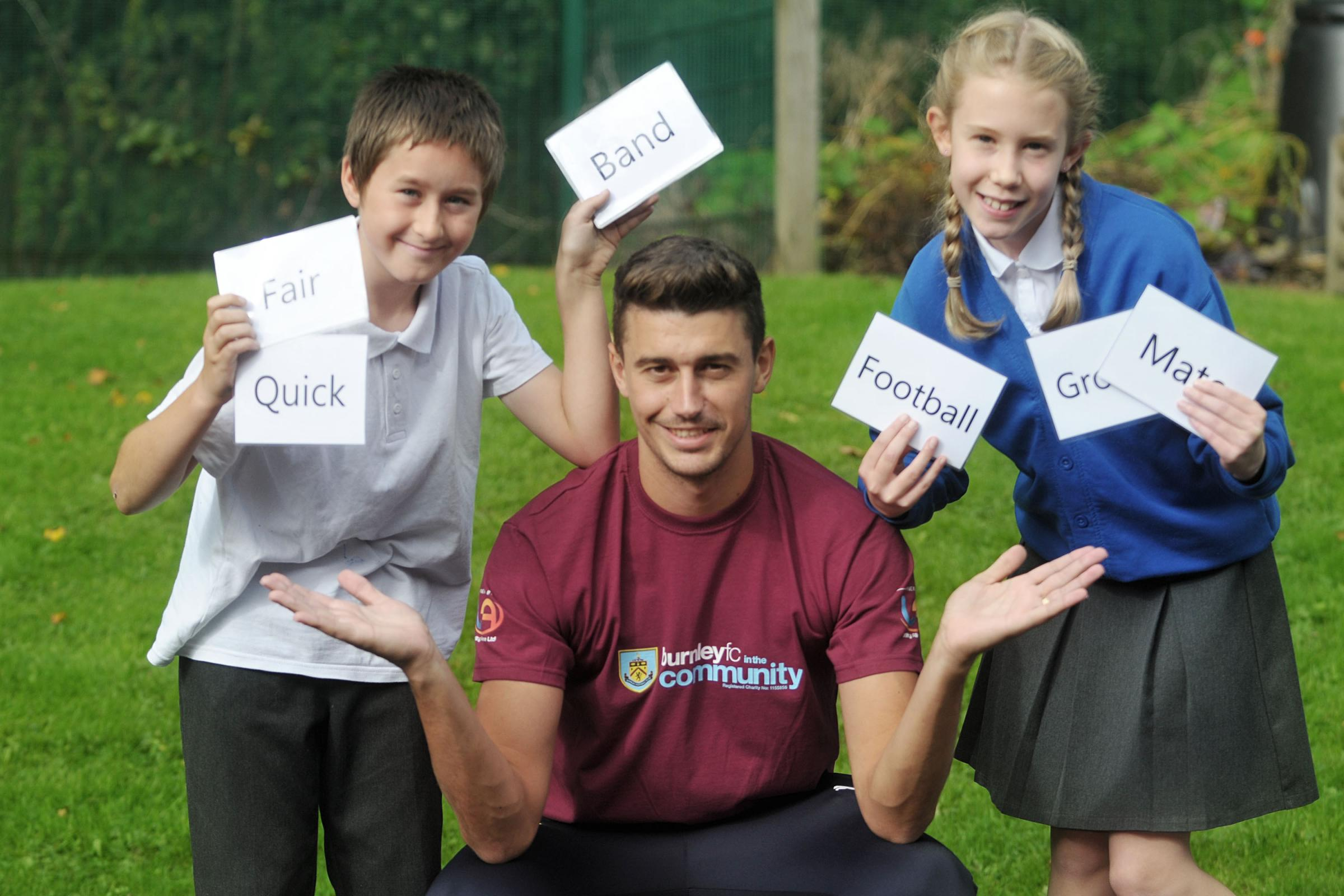 Burnley defender Matt Lowton and Padiham pupils Theo Wilkinson and Emily Watmough at the Premier League's Writing Stars event