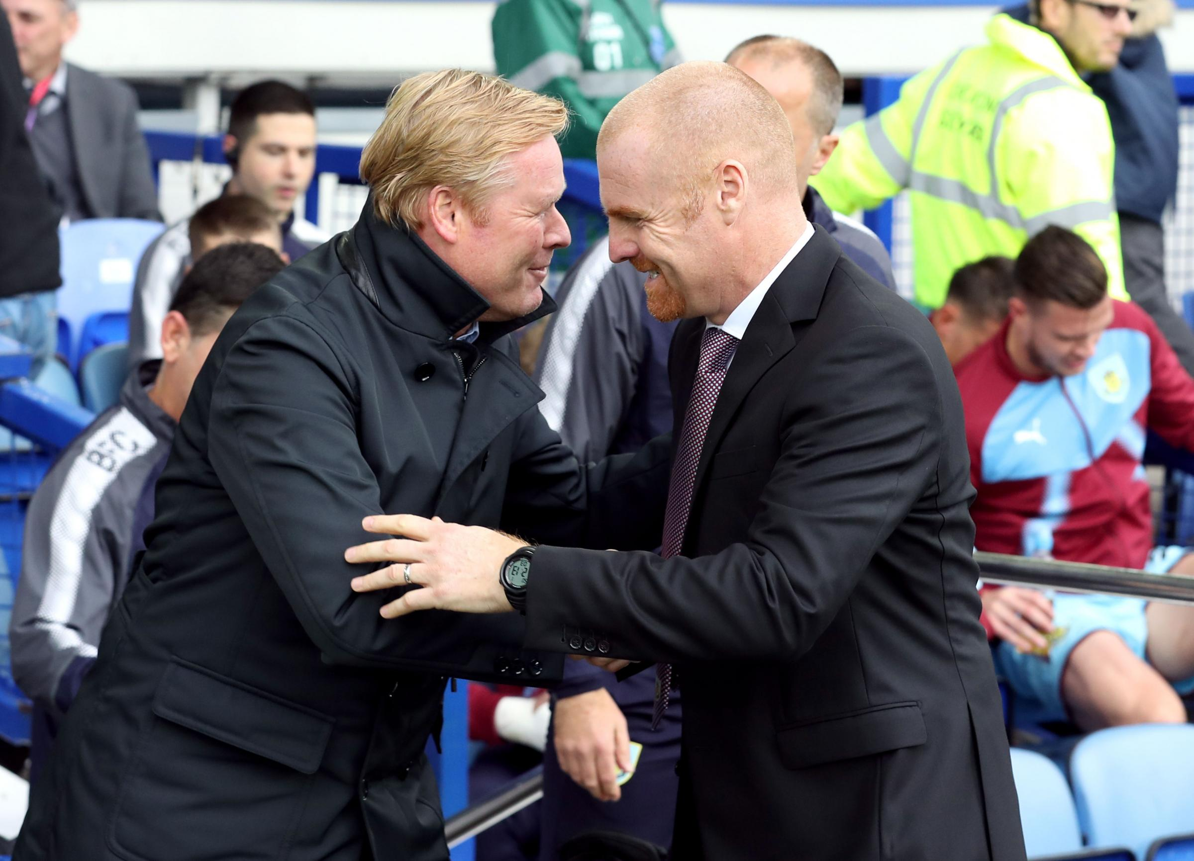 Sean Dyche and Ronald Koeman share a joke before Burnley's win at Everton