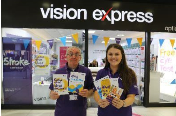 John Gott and Vicky Cheshire outside Vision Express in Blackburn