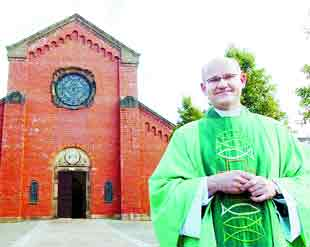 WELCOME: Fr Robert Pytel outside st Anne's Church, Blackburn  where he is now taking masses in Polish