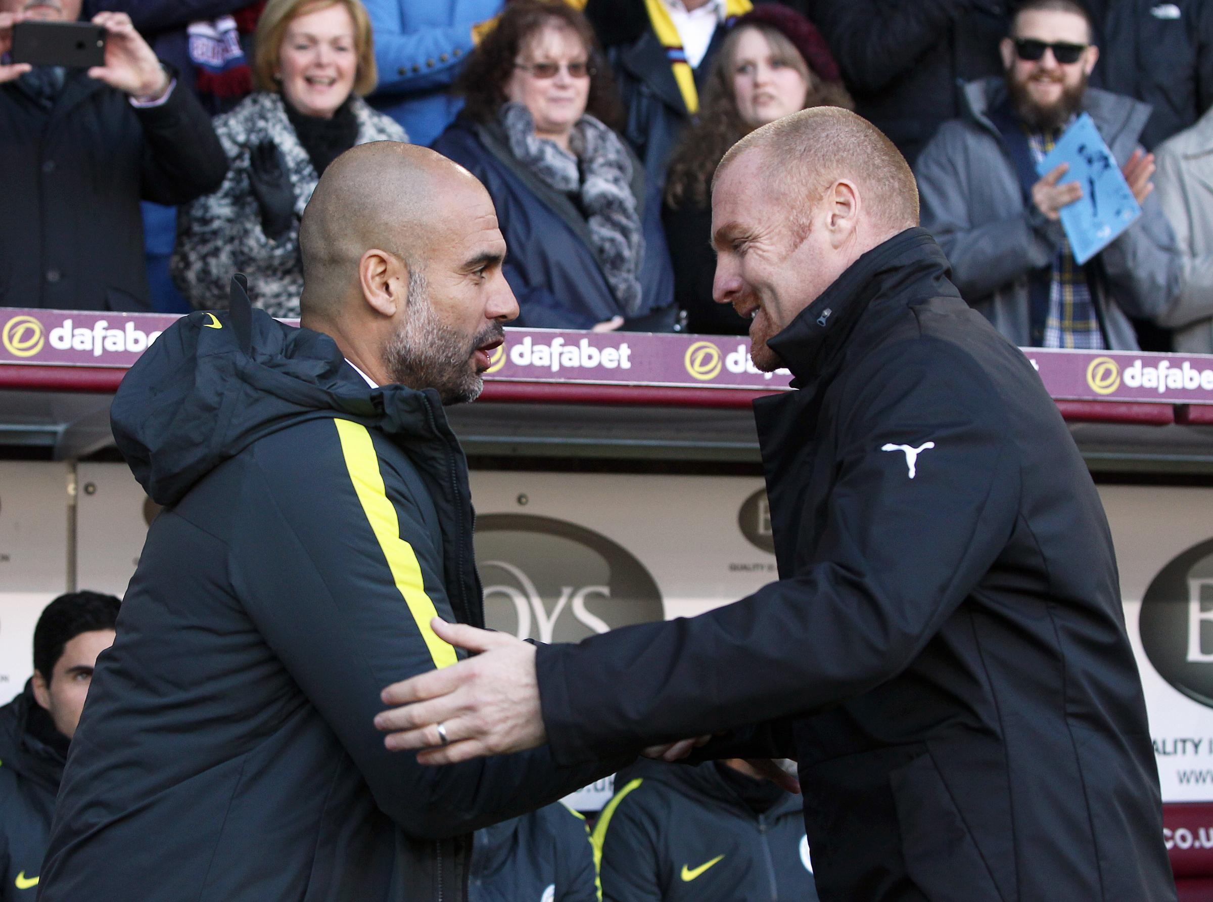 Pep Guardiola and Sean Dyche share a handshake before last year's Turf Moor clash