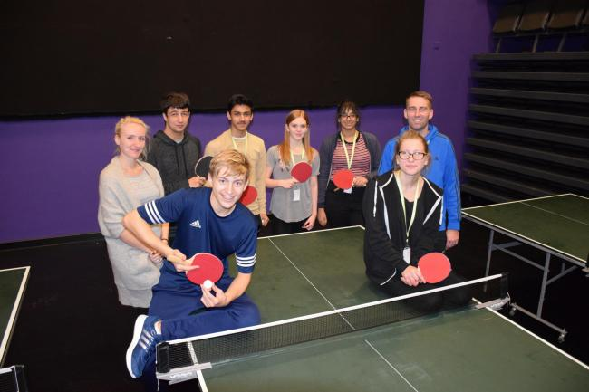 NCC's Project Lead Alexis Turner (left) and Multi-Sports Coach Marek Ellis-Ebbrell (right) with students during a Table Tennis session
