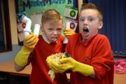 Fatberg class at Bacup Holy Trinity school, Stacksteads, children learn what not to flush and throw away down our pipes from left Chloe Walker, Thomas Thompson show what to flush and what not to flush as Hallie Sabri uses a bucket and pole to recreate a t