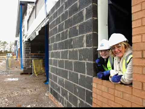 Headteacher at Ridgewood Fran Entwistle looks out of the window of her new office with pupil Charlotte Broxup, 14