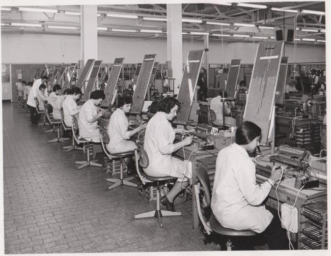 Soldering leads to flat foil capacitors at Mullard's, Blackburn, 1973