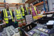 Volunteers organising items for the Food Share, at the warehouse within Accrington and Rossendale College