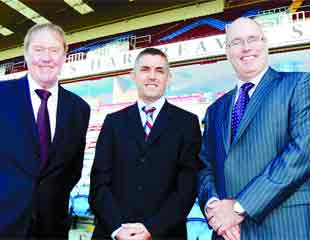 NEW DEAL: Burnley chairman Barry Kilby and manager Owen Coyle with Gordon Rothwell