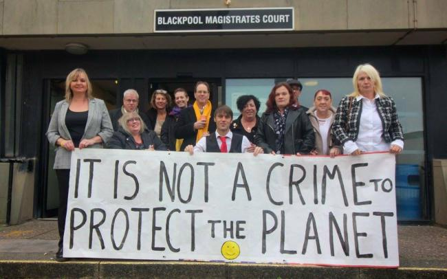 The 12 protestors outside Blackpool Magistrates Court