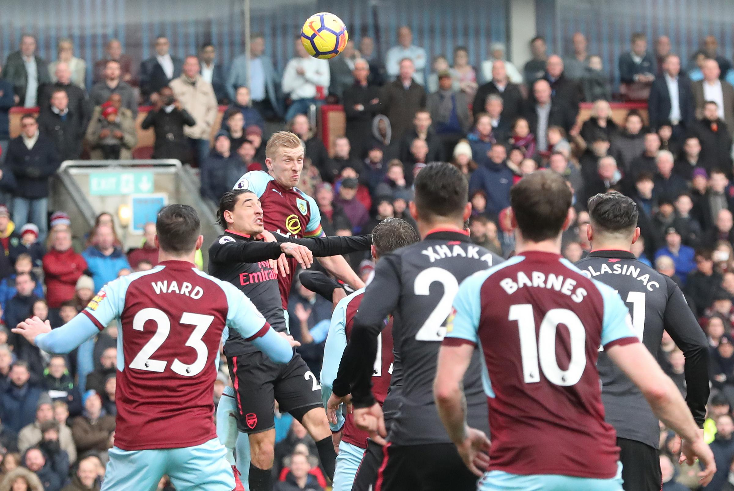 Ben Mee rises high to win a header against Arsenal