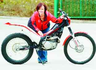 WHEELIE COOL: Caroline Sandiford with a Montesa bike similar to the one used in the new Bond film