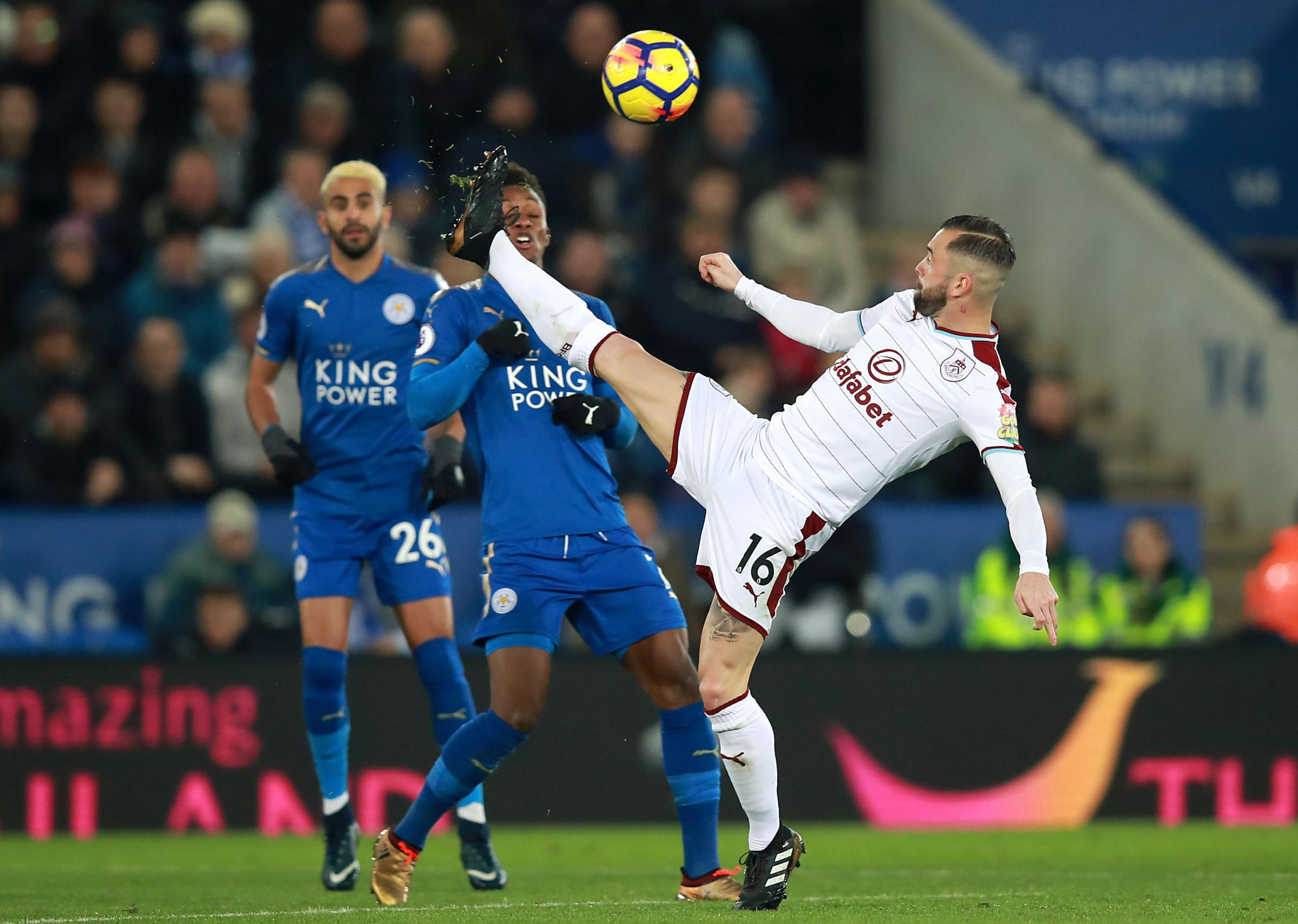 Steven Defour battles to keep hold of the ball against Leicester