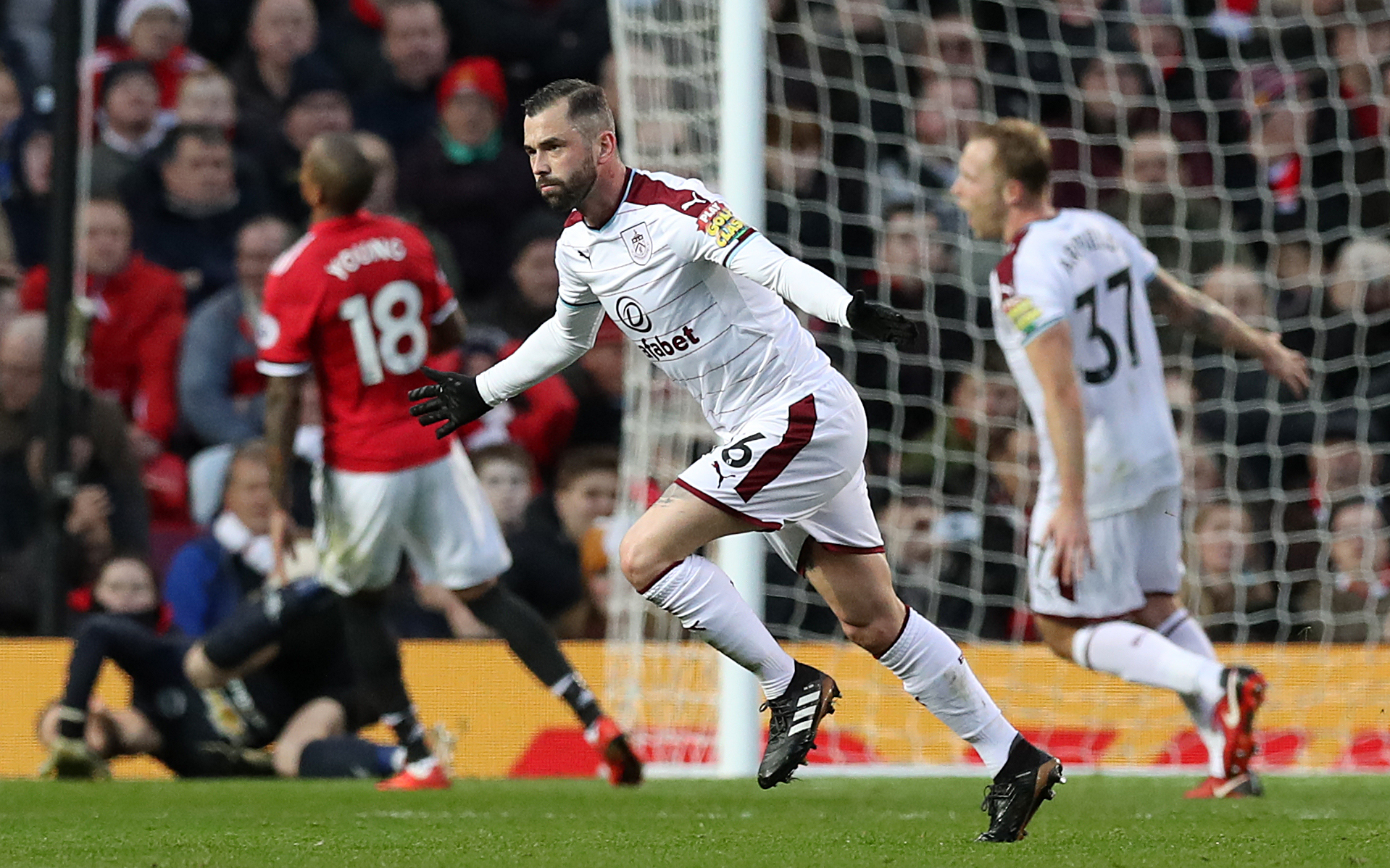 Steven Defour celebrates his stunning free-kick against Manchester United