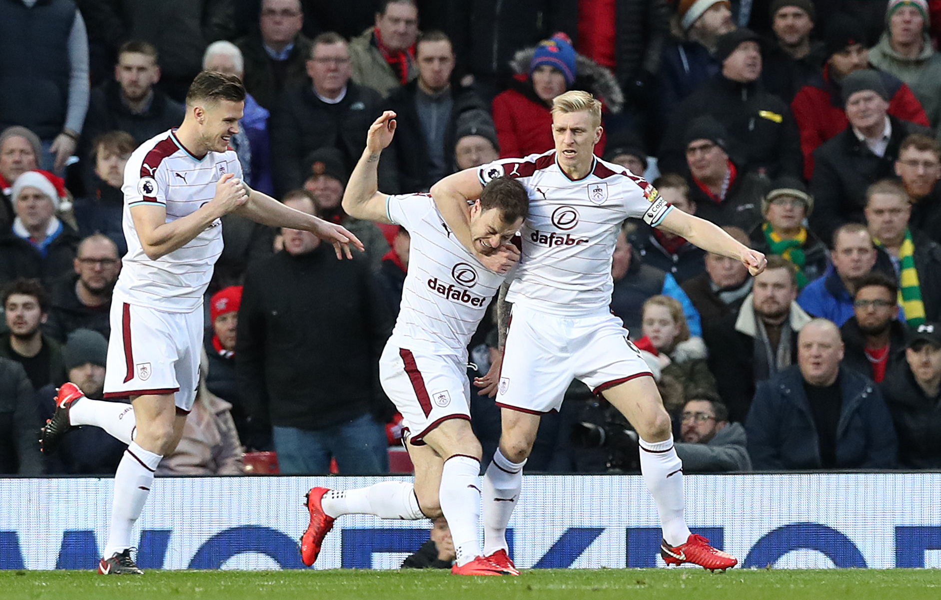 Ben Mee celebrates with Ashley Barnes after Burnley took the lead at Old Trafford