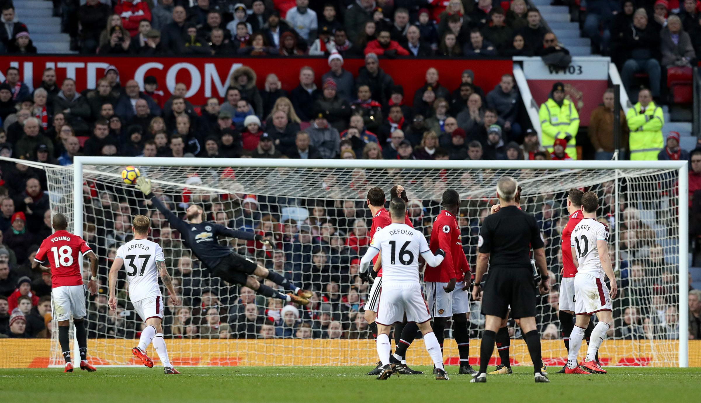 Steven Defour watches his sensational free-kick fly past David De Gea at Old Trafford