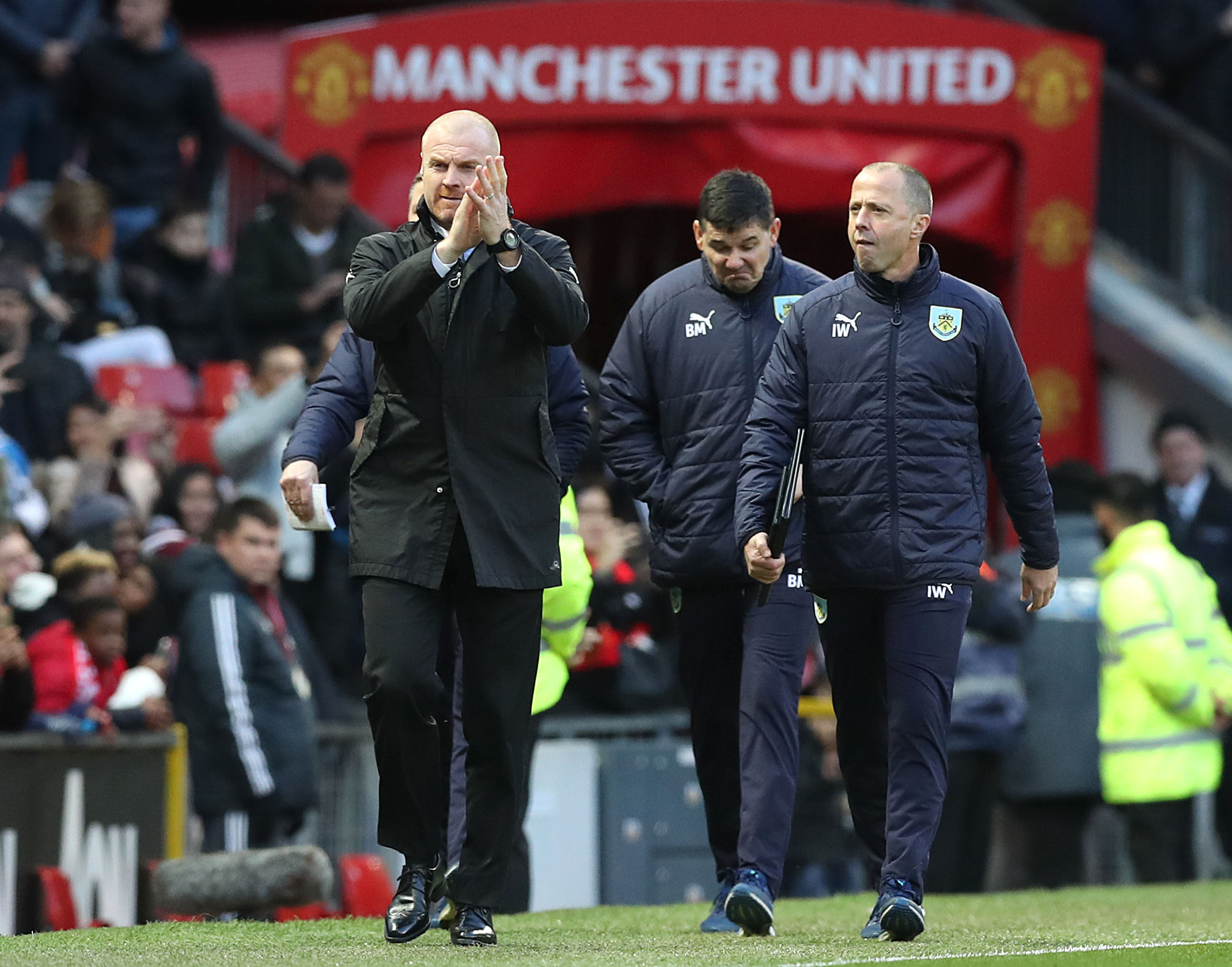 Sean Dyche applauds the Burnley fans at Old Trafford as the Clarets claim another fine away result