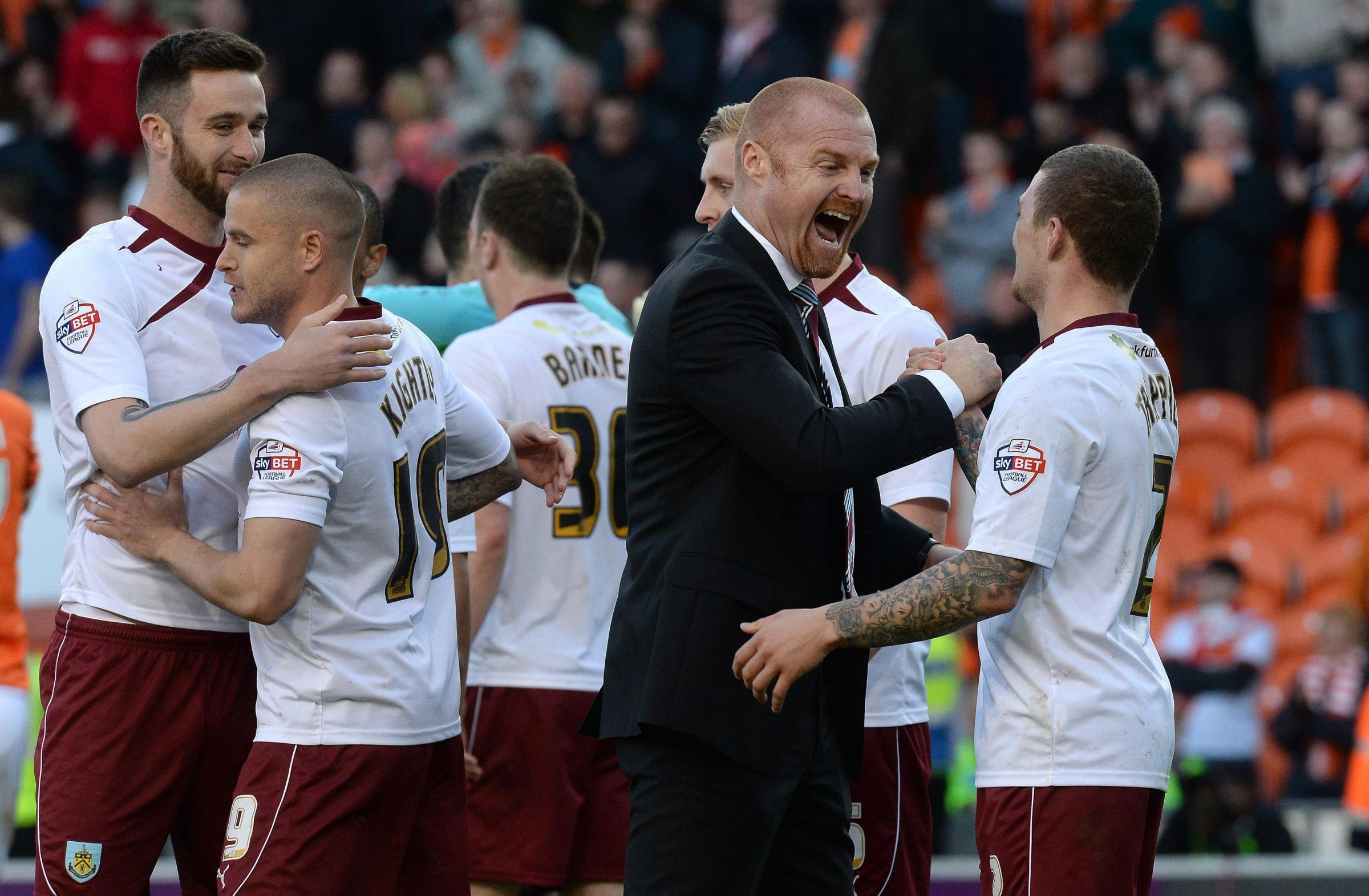Sean Dyche and Kieran Trippier share a joke during their time together at Burnley